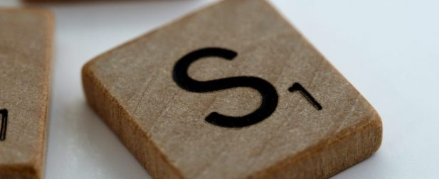 scrabble piece of the letter S