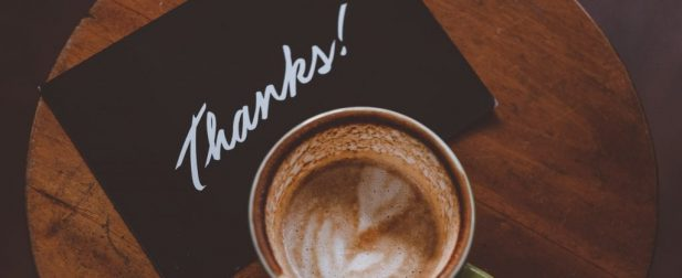 coffee and thank you card on table