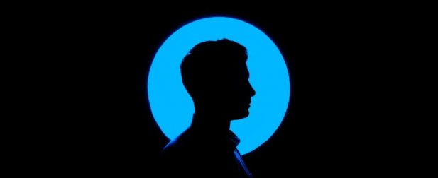 Silhouette of a man with blue circle behind his head
