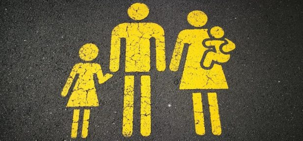 Yellow stick family painted on ground