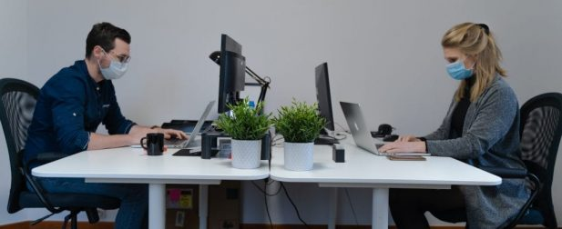 Employees Social Distanced at a Desk